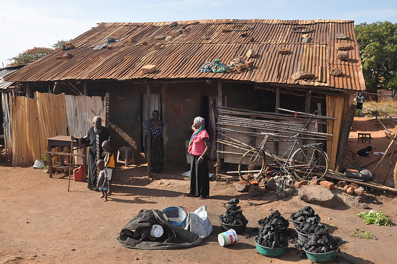 Residents at a house to be demolished in Gulu, Uganda